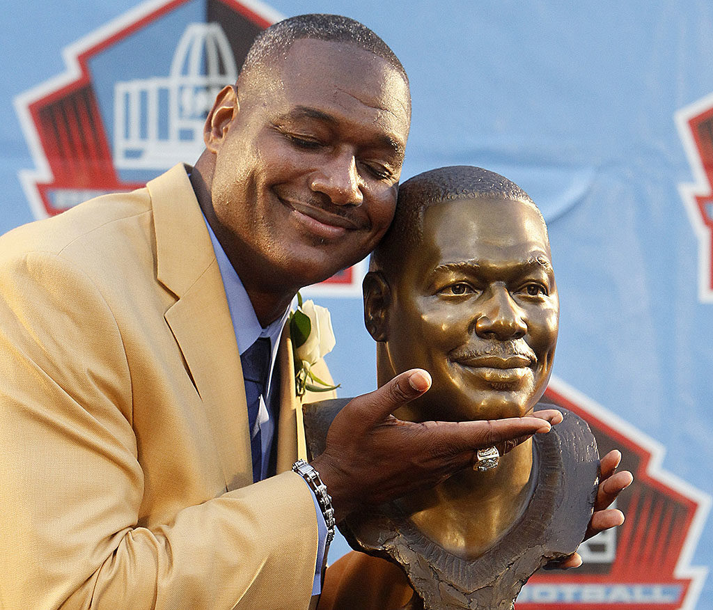 DIRK SHADD   |   Times   Tampa Bay Buccaneers legendary linebacker Derrick Brooks hugs his bust after his speech on stage during the Hall of Fame Enshrinement Ceremony in Canton Saturday evening (08/02/14).