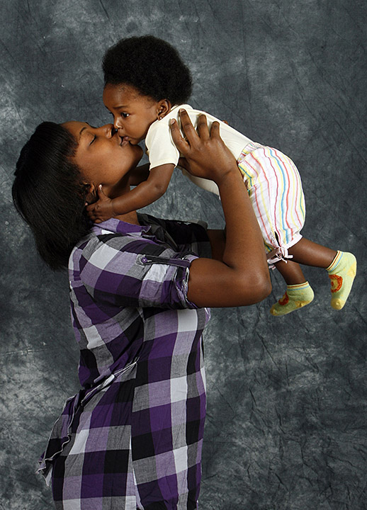 DIRK SHADD   |   Times SP_316011_SHAD_HELPPORTRAIT_05 (12/12/2009 St. Pete) Sade Candace Tulloch (cq) pictured with her son Zyana Francis, eight months old, from St. Petersburg, as she poses for a picture for the Help Portrait during the YWCA Christmas party at the First United Methodist Church, 212 3rd Street North, in St. Petersburg. [DIRK SHADD, Times]
