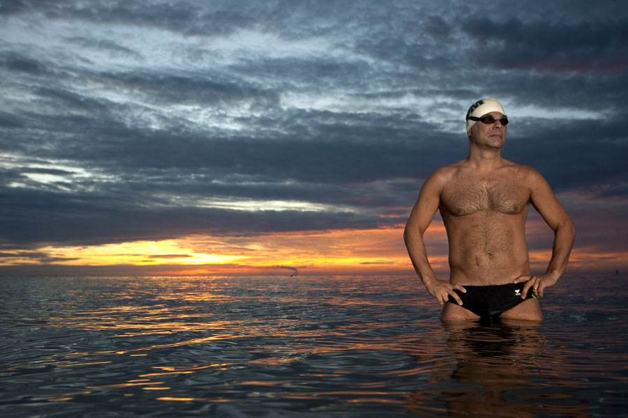 Ron Collins, 48, pictured in the Tampa Bay at sunrise at North Shore Park after his morning in St. Petersburg. Collins is about to attempt the third leg of the Triple Crown of ocean swimming, the 20-mile swim from Catalina Island to mainland California. Collins has already swam around Manhattan and he has completed the English Channel.