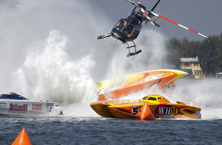 A power boat flips while coming into the first turn at the start of the APBA Offshore National Championships off the St. Petersburg Pier.