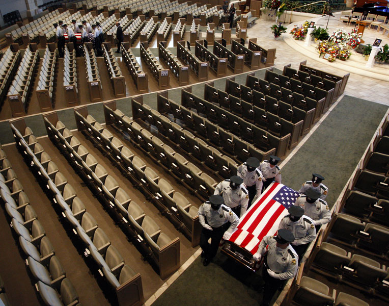 The caskets are carried down the isles as they are taken outside of the church at the end of funeral services for Sergeant Thomas Baitinger and K-9/TAC Officer Jeffery Yaslowitz at the First Baptist Church of St. Petersburg. Pictured in foreground (on right) is the casket of K-9/TAC Officer Jeffery Yaslowitz. In background on far left is the casket of Sergeant Thomas Baitinger.