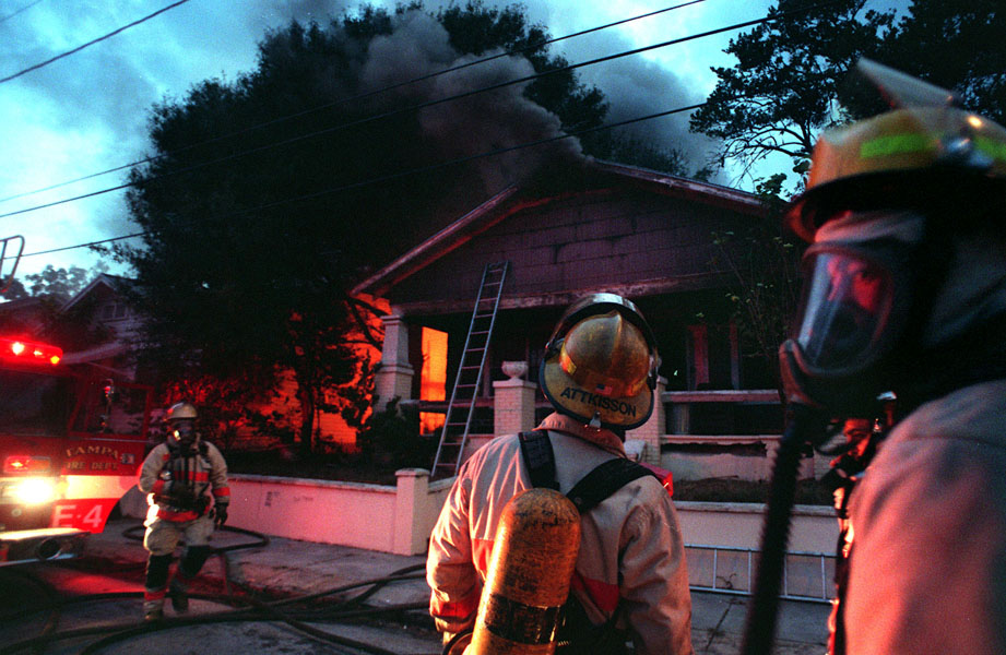 Tampa Fire Rescue workers battle a house fire at 3006 N. Ybor Street in Tampa.