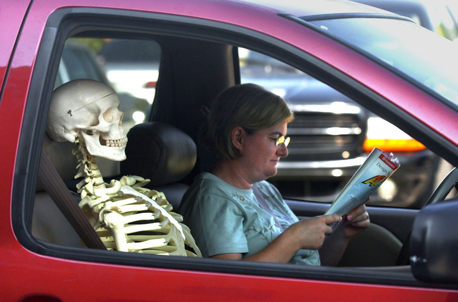 """SP 141493 - - DELIVER TO: METRO - - 5/30/2002 - - ST. PETE - - CAPTION INFO: *** -1/1- A teaching skeleton waits while buckled into the passenger seat along with Marlaine Ritch (cq) while she waits to pick up her son Matthew Ritch (cq) (not pictured), 12, a 7th grader, in front of Canterbury School of Florida, at 901 58th Ave. NE., in St. Petersburg. Ritch had picked up the teaching skeleton from Mary Ingram's fourth grade class at the Canterbury School of Florida's campus at 1200 Snell Isle Blvd NE. The class was using the skeleton to learn the bones in the body. """"It was a riot,"""" Marlaine Ritch said about driving with the skeleton in her car. """"Some of the kids just pointed and laughed,"""" Ritch said.  - - Times Photo By: Dirk Shadd - - Story By: none - - SCANNED BY: dirk - - RUN DATE: 5/31/2002"""