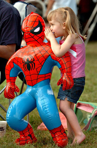 -1- CAPTION: (03/12/2006 St. Petersburg) Madison Bowers (cq), 3 1/2, whispers a secret into the ear of her spiderman blowup figure that she won at the Cajun-Zydeco Crawfish Festival in Vinoy Park, Fifth Avenue NE at Bayshore Drive  in St. Petersburg Sunday afternoon (3/12/06). Madison also won an identical spiderman figure for her little sister Hannah Bowers, 2 1/2. Unfortunately for Spidey, Hannah kept calling her action hero by the name of Superman. The two sisters were accompanied by their parents, Tabatha and Mike Bowers, of Valrico. STORY SUMMARY: The three day festival, which featured 10,000 pounds of crawfish, ended Sunday with Creole and Louisiana culture, fiery foods, arts and crafts and more. (Times photo by Dirk Shadd).