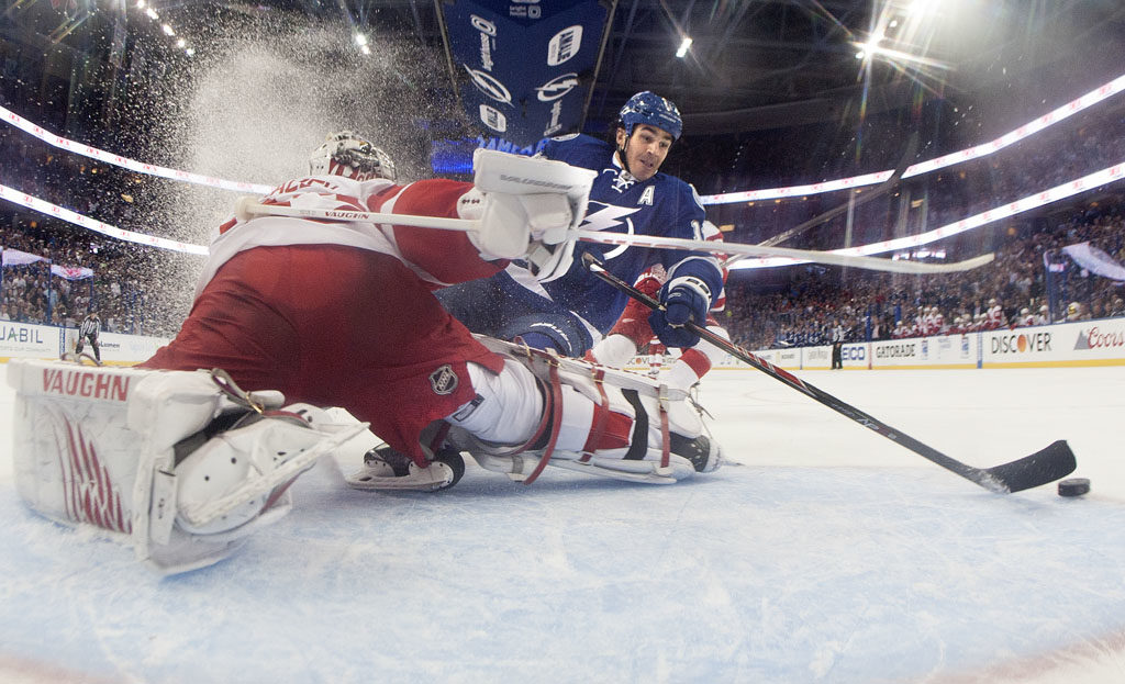 Tampa Bay Lightning center Brian Boyle (11) beats Detroit Red Wings goalie Petr Mrazek (34) shorthanded to tie the game 1 to 1 during first period action in game one of the opening round of the Stanley Cup playoffs at the Amalie Arena in Tampa Thursday evening (04/16/15).