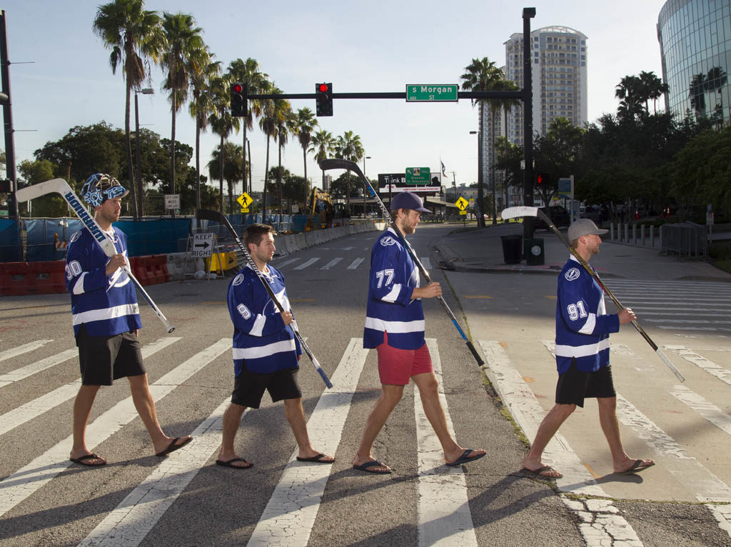 DIRK SHADD   |   Times Special section cover for the opening of the 2016-2017 Tampa Bay Lightning season. The Band is Back Together! Break out the vinyl with this Abbey Road Beatles album cover recreation. From left is Tampa Bay Lightning goalie Ben Bishop (30), center Tyler Johnson (9), defenseman Victor Hedman (77) and center Steven Stamkos (91).  Instead of crossing Abbey Road in London, this fab four is crossing Channelside Drive with the Amalie Arena up ahead on right.