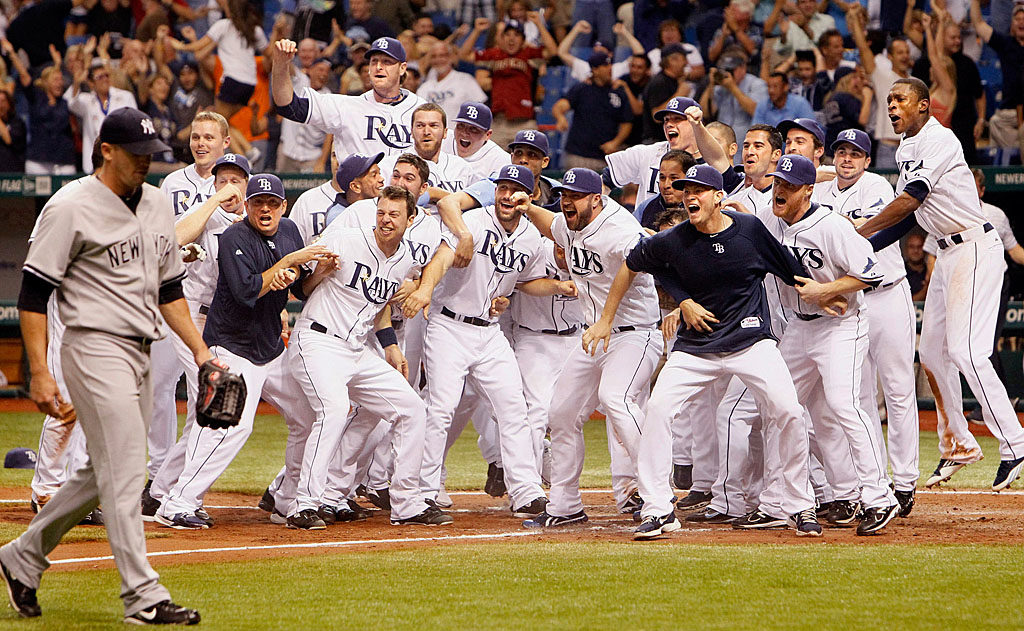 DIRK SHADD   |  Times  SP_344613_SHAD_RAYS_18 (09/28/11) Tampa Bay Rays celebrate at home plate as Evan Longoria connects for the game winning home run against the New York Yankees at Tropicana Field in St. Petersburg Wednesday evening (09/28/11). [Dirk Shadd, Times]