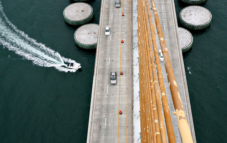 Sunshine Skyway - A view of the peeling paint on the stay cables high atop of the tower looking down as traffic flows below on the Sunshine Skyway Bridge.