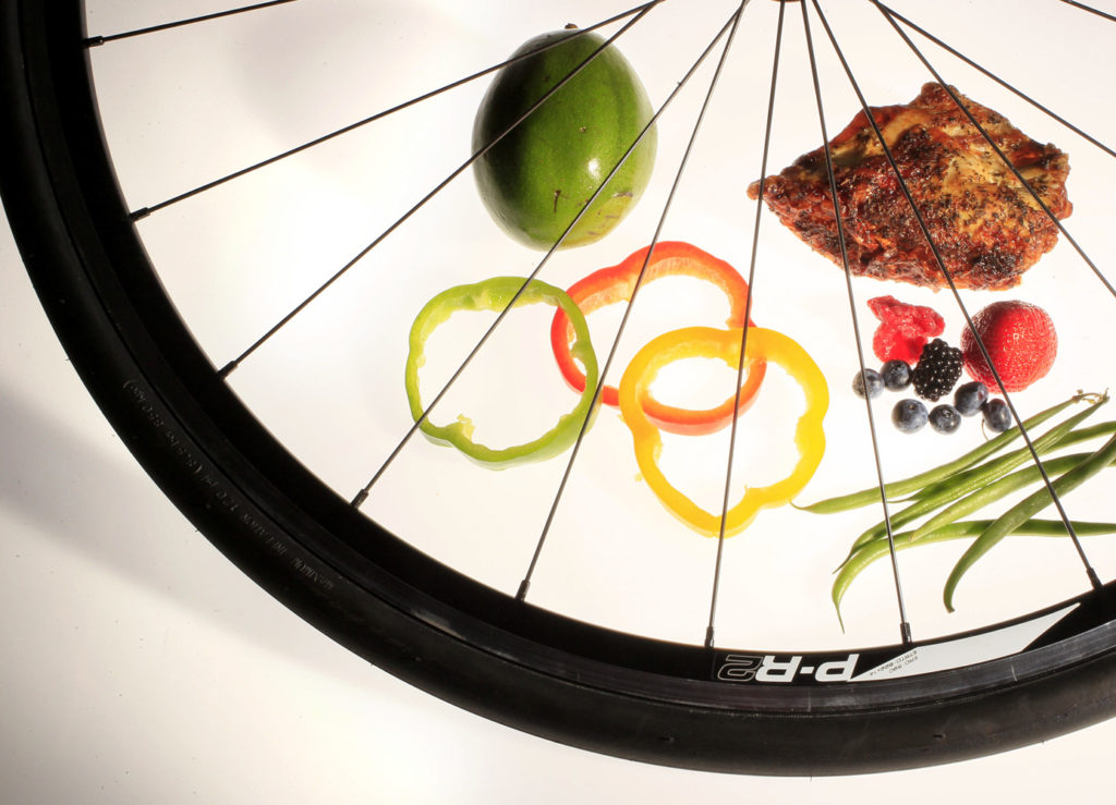 DIRK SHADD   |  Times  SP_357205_SHAD_PERSONALBEST_01  (07/19/12 ST. PETE) PERSONAL BEST: cover photo pictured in the Times studio.  Some of the foods suggested to eat for energy, pictured through the spokes of a Giant Avail bike wheel.  (NOTE: bike wheel supplied to the Times from St. Pete Bicycle and Fitness, 1205 4th Street N.-- please give credit to this bike shop for letting us borrow the prop.) [DIRK SHADD   |  Times]