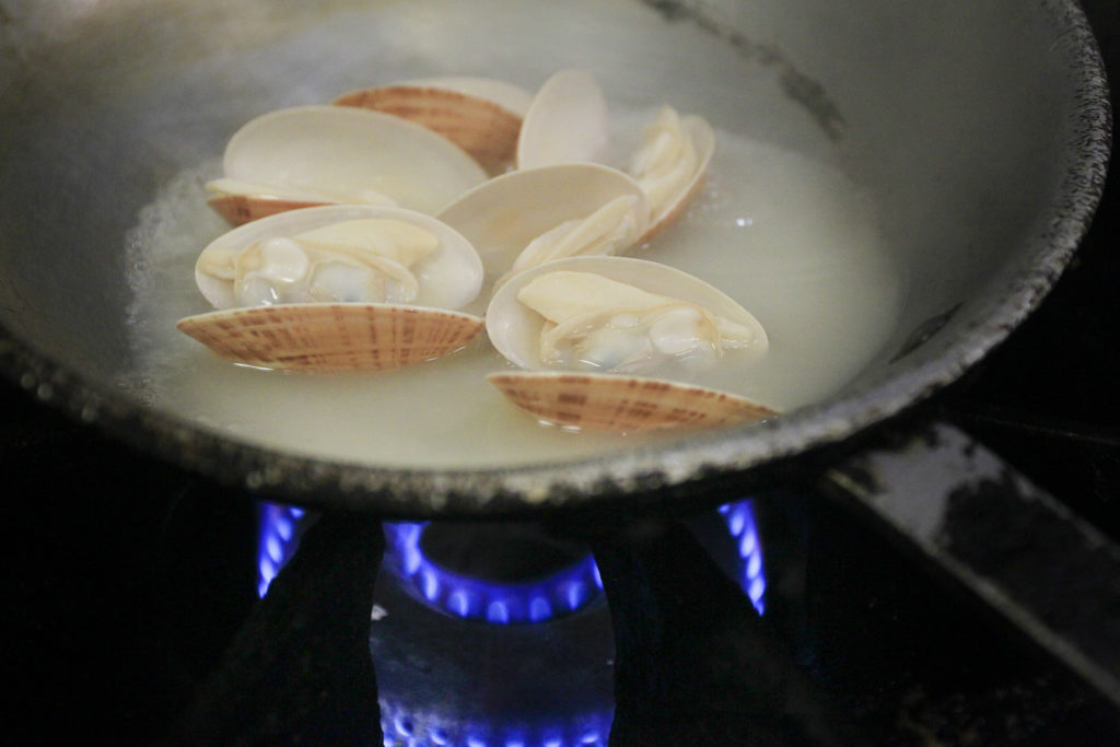 DIRK SHADD   |   Times   Sunray venus clams as they are being cooked in the kitchen at the Sandbar Restaurant, 100 Spring Avenue, on Anna Maria Island Sunday afternoon (08/09/15).