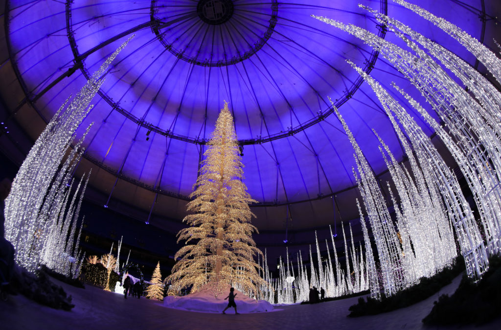 The 80-foot lighted pine Christmas tree at the center of the maze at Enchant Christmas as Tropicana Field turns into a massive holiday winter wonderland on opening night on Friday, Nov. 22, 2019 in St. Petersburg.