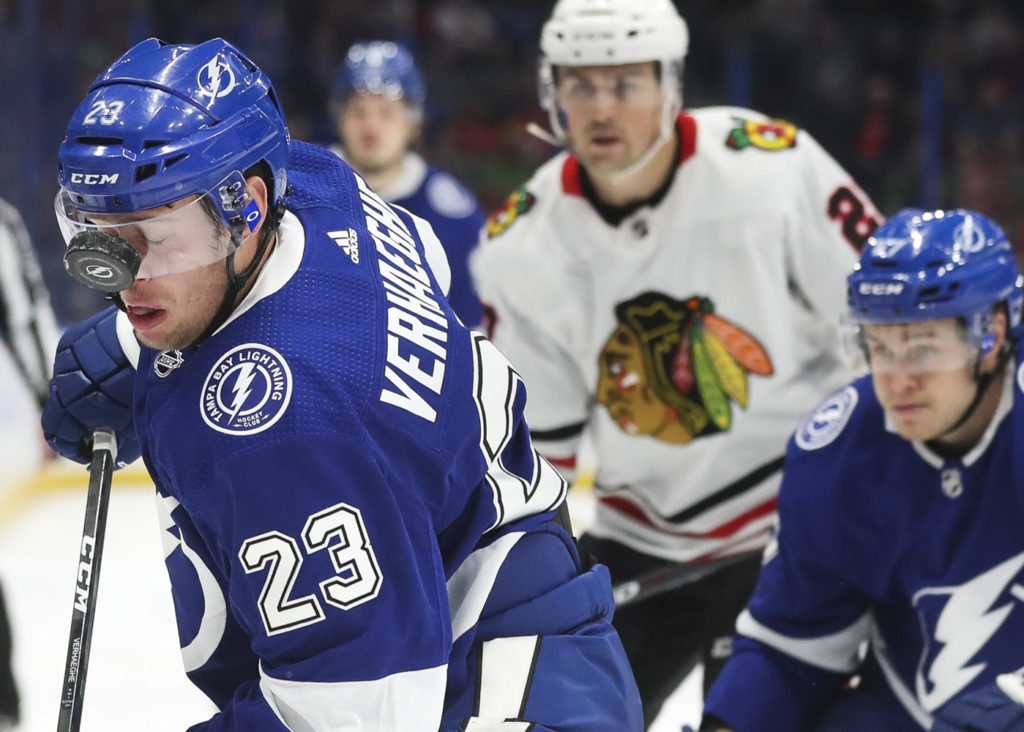 Tampa Bay Lightning center Carter Verhaeghe (23) takes a puck off the face shield against the Chicago Blackhawks during first period action at Amalie Arena on Thursday, Feb. 27, 2020 in Tampa.