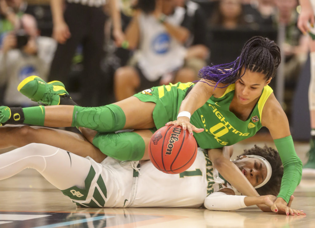 DIRK SHADD   |   Times Oregon Ducks forward Satou Sabally (0) falls over Baylor Lady Bears forward NaLyssa Smith (1) while chasing the ball during the first half of their NCAA Women's Final Four semi-final game Friday, April 5, 2019 in Tampa.
