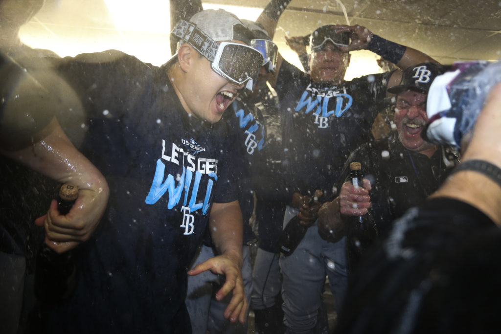 Tampa Bay Rays Ji-Man Choi (26) celebrates with his team in the club house as they clinching a spot in the playoffs after defeating the Toronto Blue Jays on September 27, 2019 in Toronto, Ontario.