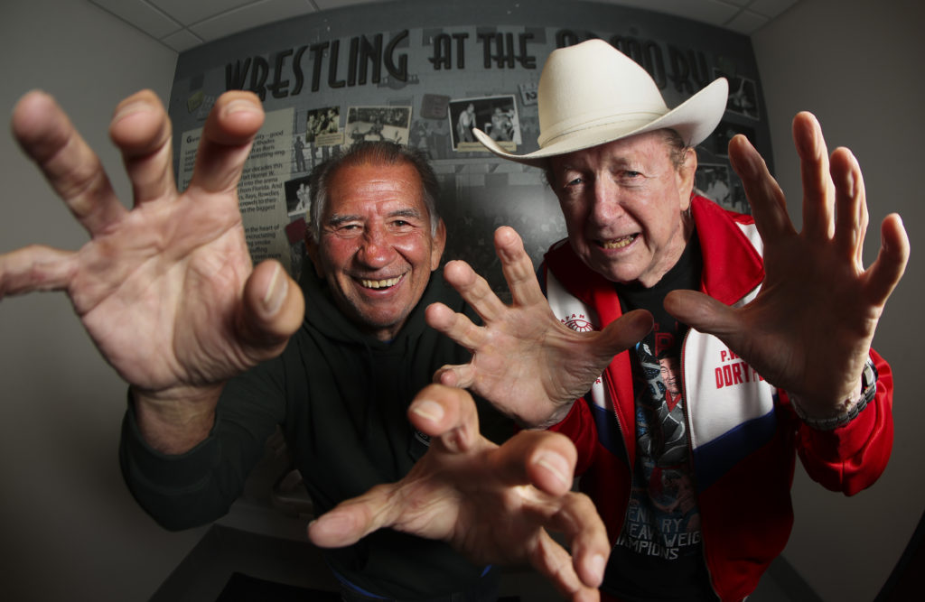 Gerald Brisco, 73, left, and Dory Funk Jr., 79, who were two of the Championship Wrestling from Florida promotion's biggest stars and were scripted bitter enemies, pictured in front of the Wrestling at the Armory wall at the Bryan Glazer Family JCC, 522 N Howard Ave, on Friday, Feb. 28, 2020 in Tampa. The Florida promotion's  was one of the premiere promotions in the country from the 1950s until it shuttered in the 1980s.