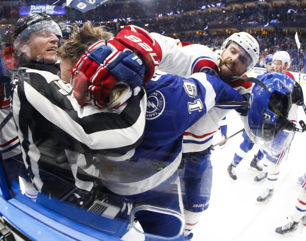 Tampa Bay Lightning center Barclay Goodrow (19), on left,  fights with defenseman Shea Weber (6), on right, as the official tries to break it up at the end of the second period at Amalie Arena on Thursday, March 5, 2020 in Tampa.