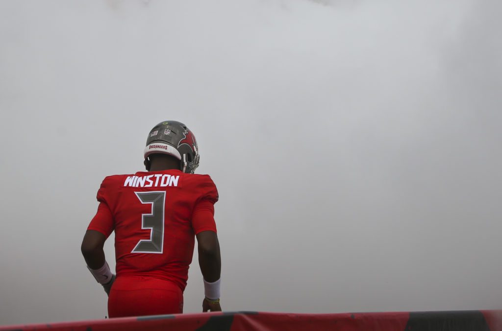 DIRK SHADD   |   Times   Tampa Bay Buccaneers quarterback Jameis Winston (3) heads out of the tunnel and onto the field with stage smoke filling the air as he is introduced before taking on the Carolina Panthers at Raymond James Stadium in Tampa Sunday afternoon (12/02/18).