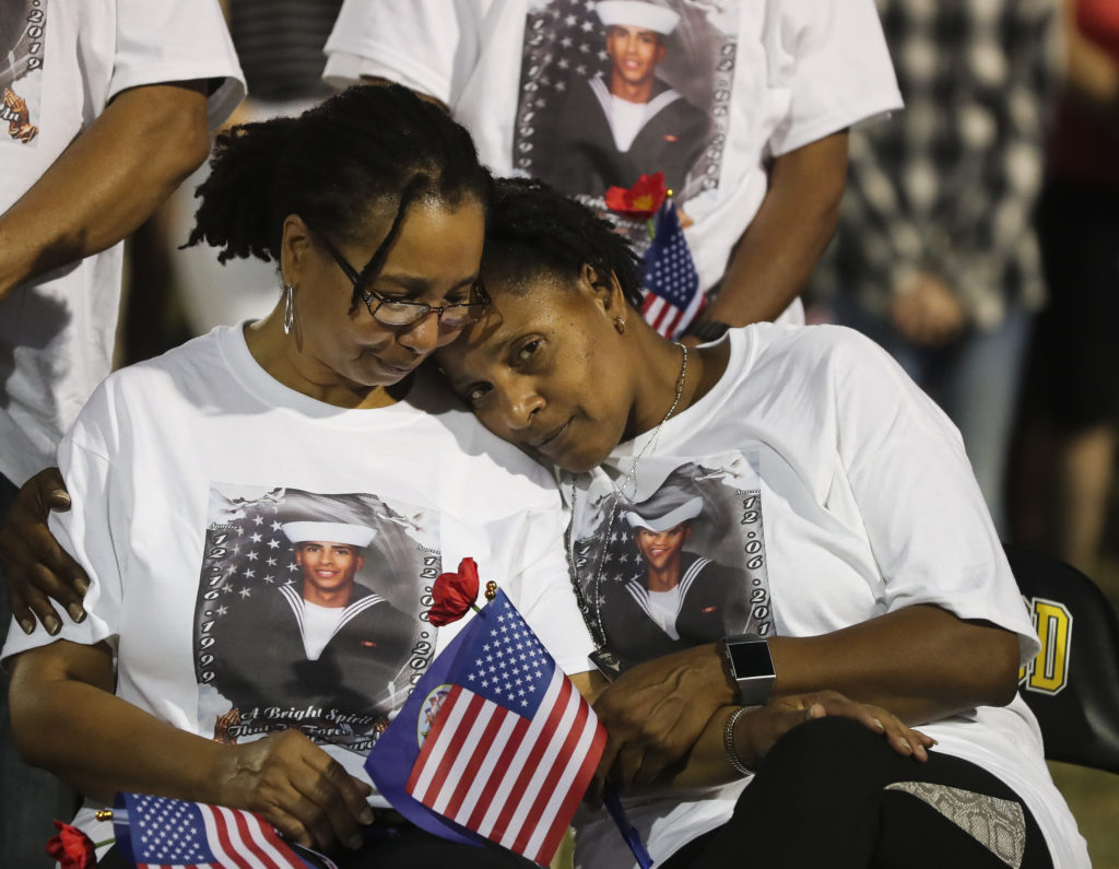 """Beverly Thomas, on left, consoles her sister Evelyn Brady, the mother of Mohammed """"Mo"""" Haitham, the former Lakewood High student and track star who was one of three sailors killed last week by a gunman at the Naval Air Station in Pensacola, during a vigil for him at Lakewood High, 1400 54th Ave S, on Monday, Dec. 16, 2019 in St. Petersburg."""