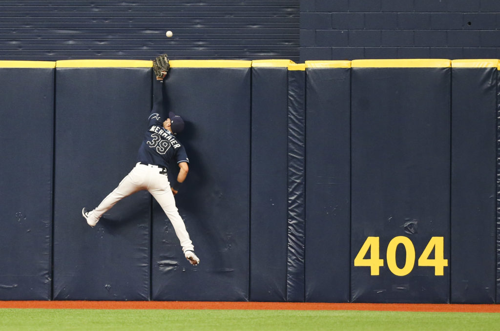 Tampa Bay Rays center fielder Kevin Kiermaier (39) goes up at the wall but is unable to come down with the ball as Toronto Blue Jays Lourdes Gurriel Jr. (13) hits a home run in the fourth inning at Tropicana Field on Wednesday, Aug. 7, 2019 in St. Petersburg. DIRK SHADD   |   Times