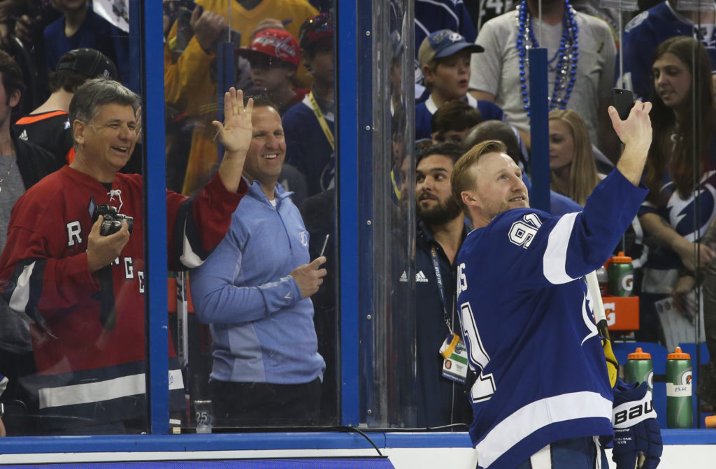 DIRK SHADD   |   Times   Tampa Bay Lightning forward Steven Stamkos (91) takes a selfie with the crowd posing behind the glass at the end of the NHL All-Star Skills Competition at Amalie Arena in Tampa Saturday (01/27/18).